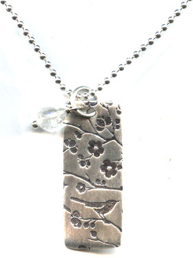 nature-inspired dog tag pendant
