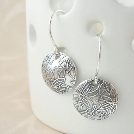 domed designer earrings