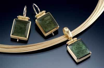 gemstone pendant and earrings